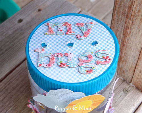 I adhered a combination of die cuts, stickers, and fussy cut images to the outside of the bug jar.  Aren't those little bees the cutest?