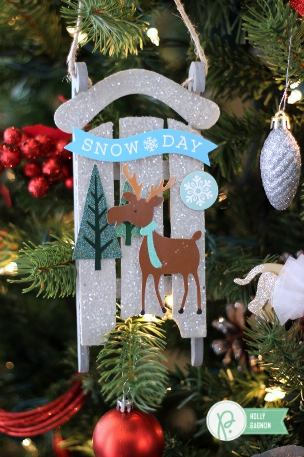 Winter Sleigh Ornament embellished with the @pebblesinc Winter Wonderland collection created by @ribbonsandglue