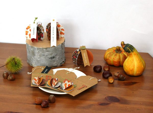 Folded paper pumpkins for Fall and Thanksgiving made by @MoniqueLiedtke using the #WoodlandForest collection from @PebblesInc.