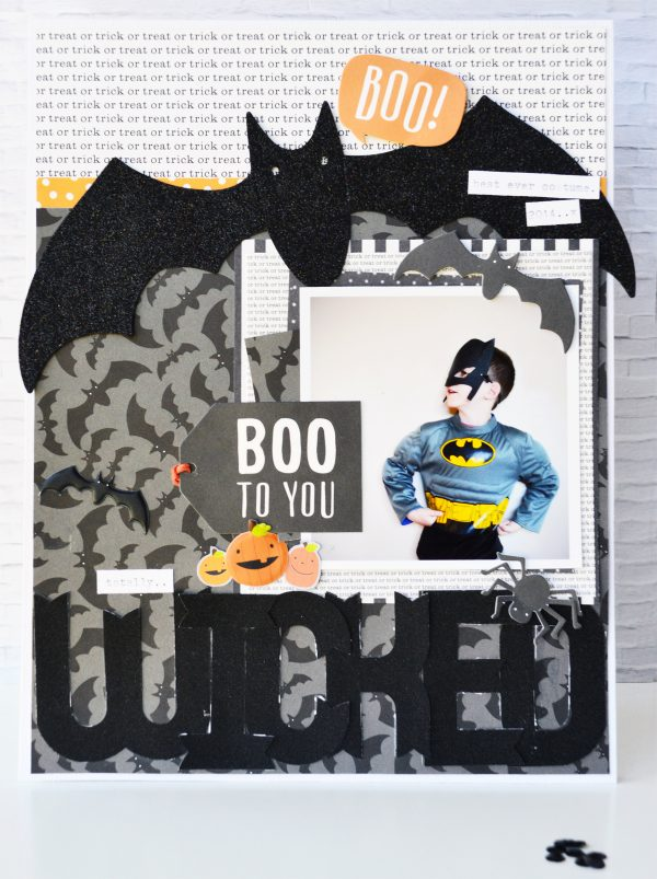 Create a Halloween layout using @PebblesInc #TrickorTreatcollection and include off the page elements as shown by @leanne_allinson .
