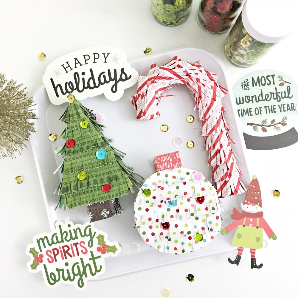 DIY Mini Christmas Pinatas by @HeatherLeopard using @PebblesInc Holly Jolly collection
