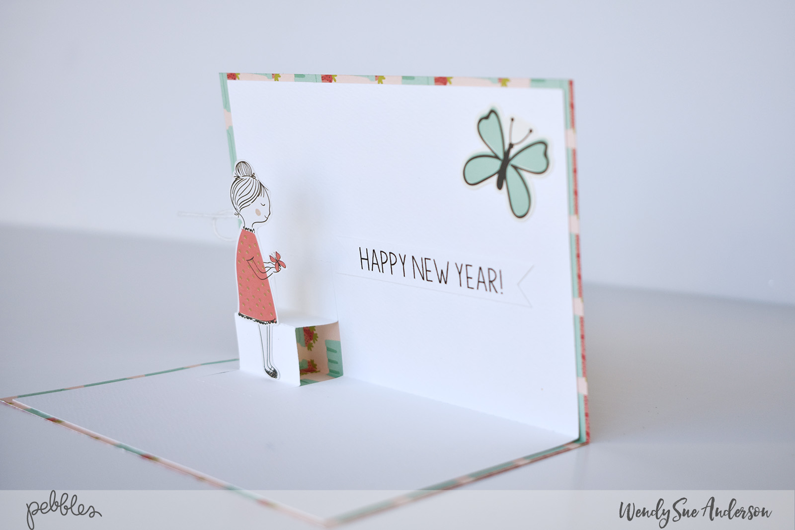 "Pop-Up New Year's Card by Wendy Sue Anderson featuring the ""Along the Way"" collection by @PebblesInc."